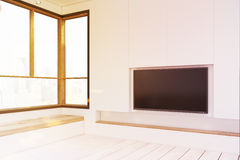 Empty room with a plasma TV, toned Stock Photography