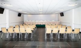 Empty room for the press conference. Modern press conference room with empty seats and multimedia equipment royalty free stock photos