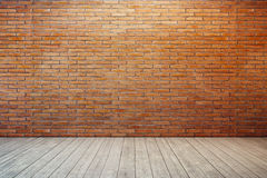 Empty room with red brick wall. And wooden floor royalty free stock image