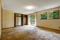 Empty room with soft carpet floor and opened walk in closet Stock Image