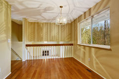 Empty room in soft ivory with new hardwood floor Royalty Free Stock Photography
