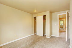 Empty room in soft ivory tones with closet Stock Photography