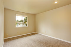 Empty room in soft ivory tones Stock Photos