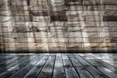 Empty room with sunbeam. Wooden floor and sandstone brick wall in empty room with sunbeam Stock Photos