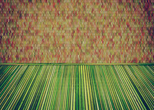 Empty room with thatch floor and colorful ceramic tiles wall. Royalty Free Stock Photo