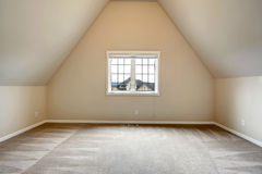 Empty room with vaulted ceiling Stock Images