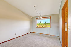 Empty room with vaulted ceiling Stock Image