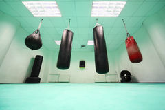 Empty room, where punching bag hang stock image