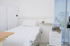 Empty room with white bed Stock Photo