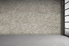 Empty Room with White Brick Wall. 3d rendering of empty modern room with white brick wall, concrete floor, and garage door Stock Photo