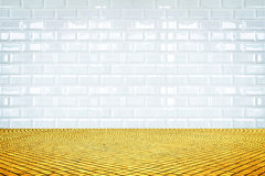 Empty room with white ceramic tile wall and golden mosaic floor, Royalty Free Stock Photo