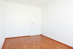 Empty room with white door Royalty Free Stock Photo