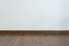 Empty room, white mortar wall background and wood laminate floor Stock Photography
