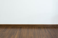 Empty room, white mortar wall background and wood laminate floor Royalty Free Stock Photo