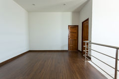 Empty room, white mortar wall background and wood laminate floor Stock Photo