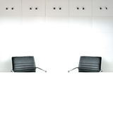 Empty room with white table and 2 working chairs Royalty Free Stock Photo