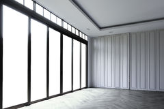 Empty room with white wall and a glass sliding door frame, beaut Royalty Free Stock Photos