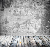Empty room with white wall and wooden floor Stock Photos