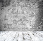 Empty room with white wall and wooden floor Royalty Free Stock Photos