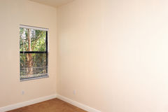 Empty room with window. View of an empty room with window, plenty of copy space Stock Images