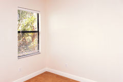Empty room with window. A clean empty room with window and blank wall with plenty of copy space Stock Image