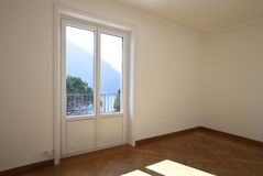 Empty room with a window Royalty Free Stock Photos