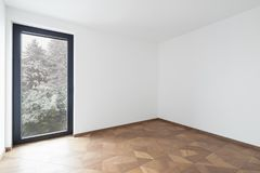 Empty room with window. It`s snowing outside royalty free stock photos