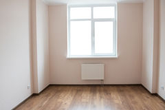 Empty room with window and wooden floor Royalty Free Stock Images