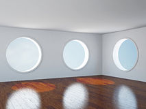 Empty room with windows. The empty room with big  round windows Royalty Free Stock Photo