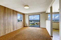 Empty room with wood plank paneled wall and carpet floor Royalty Free Stock Photo