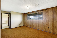 Empty room with wood plank paneled wall and view of Gig Harbor b Royalty Free Stock Photo