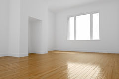 Empty room with wooden floor. A clean fresh unfurnished room with a window, wooden floor and white painted walls royalty free illustration