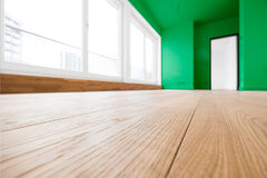 Empty room, wooden floor in new apartment. Empty room with wooden floor in new apartment royalty free stock photos