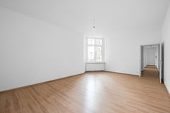 Empty room, wooden floor in new apartment. Empty white room, wooden floor in new apartment royalty free stock photos