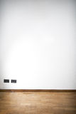 Empty room with wooden parquet