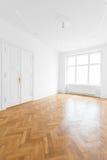 Empty room with wooden parquet floor Stock Photography