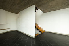 Empty room, wooden staircase Royalty Free Stock Photo