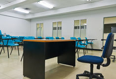Empty room wth many armchairs. Can be use as classroom or metting room Royalty Free Stock Image