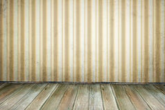 Empty Room yellow. An empty room in vintage style. Dirty striped wallpaper, boards floor Royalty Free Stock Photography