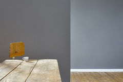 Empty rooms in loft table chair and espresso cup. 