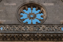 Empty rose window detail in the main facade of the Leon cathedra. Stoned rose window and balustrade in main facade of gothic leon Cathedral in spain Royalty Free Stock Photography