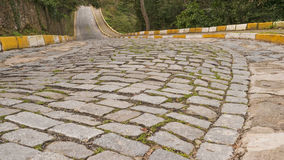 Empty rough cobblestone pavement daytime Royalty Free Stock Photo