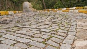 Empty rough cobblestone pavement daytime. Empty cobblestone pavement day time royalty free stock photo