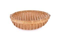 Empty round bamboo basket on white background Royalty Free Stock Photos