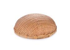 Empty round bamboo basket on white background Stock Images