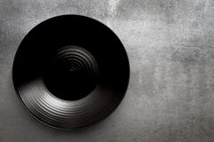 Empty Round Black Plate over Slate Stock Photos