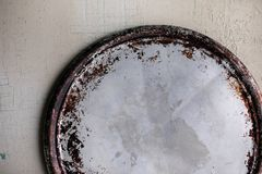 Empty round cast-iron pan for pizza on a background, place for text. Empty round cast-iron pan for pizza on a light background, place for text royalty free stock image