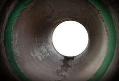 Empty round concrete tunnel interior. Glowing end of an empty round concrete tunnel interior Royalty Free Stock Image
