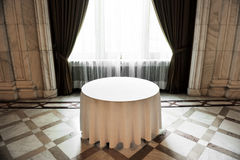 Empty round dinner table Royalty Free Stock Photo