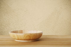 Empty round wooden plate on wood table background, food display Royalty Free Stock Photos